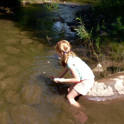 child in creek